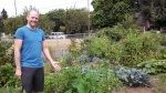 Matt with his community garden plot